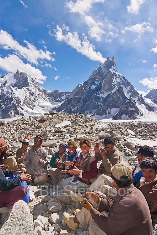 A group of Pakistani men singing a Balti folk song on the Biafo Glacier in the Karakoram mountains of Pakistan