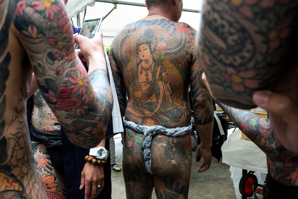 TOKYO, JAPAN - MAY 14: Yakuza members proudly display their tattoos during the second day of the Sanja Matsuri Festival in Tokyo's Asakusa district on May 14, 2016. This festival is one of the rare times when members of the notorious Yakuza gang reveal themselves to public and take photo with festival goers.<br /> <br /> <br /> Photo: Richard Atrero de Guzman