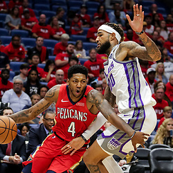 Oct 19, 2018; New Orleans, LA, USA; New Orleans Pelicans guard Elfrid Payton (4) drives past Sacramento Kings center Willie Cauley-Stein (00) during the first quarter at the Smoothie King Center. The Pelicans defeated the Kings 149-129. Mandatory Credit: Derick E. Hingle-USA TODAY Sports