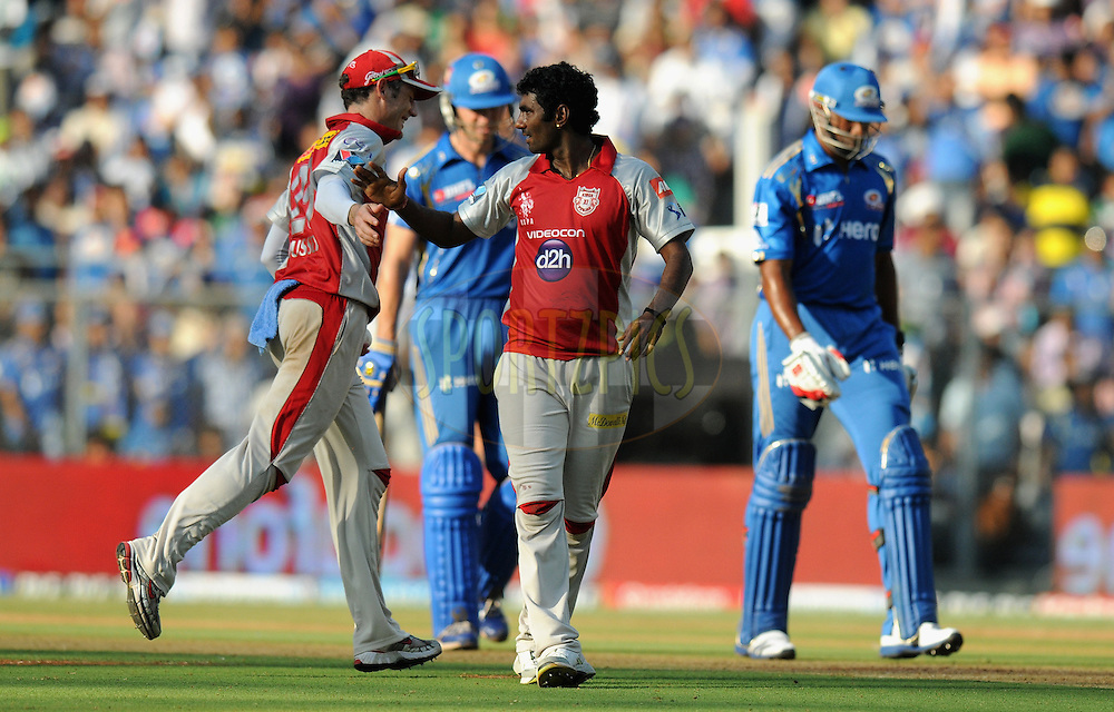 Parvinder Awana of Kings XI Punjab celebrate the wicket of Kieron Pollard of Mumbai Indians during match 28 of the Indian Premier League ( IPL) 2012  between The Mumbai Indians and the Kings X1 Punjab held at the Wankhede Stadium in Mumbai on the 22nd April 2012..Photo by Pal Pillai/IPL/SPORTZPICS.