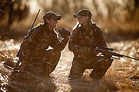FEMALE DEER HUNTERS TAKING A BREAK TO CHAT WHILE HUNTING