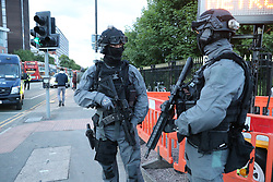 Armed police outside the venue during the One Love Manchester benefit concert for the victims of the Manchester Arena terror attack at Emirates Old Trafford, Greater Manchester.