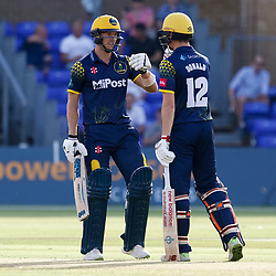 Glamorgan's Aneurin Donald with team-mate Craig Meschede celebrate a boundary<br /> <br /> Photographer Simon King/Replay Images<br /> <br /> Vitality Blast T20 - Round 8 - Glamorgan v Gloucestershire - Friday 3rd August 2018 - Sophia Gardens - Cardiff<br /> <br /> World Copyright © Replay Images . All rights reserved. info@replayimages.co.uk - http://replayimages.co.uk