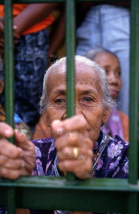 Yogyakarta,Indonesia, a woman  behind the gates of the palace of the Sultan to attend the celebration of the birth of Muhammad.<br />