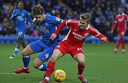Alex Woodyard of Peterborough United in action with George Thomas of Scunthorpe United - Mandatory by-line: Joe Dent/JMP - 01/01/2019 - FOOTBALL - ABAX Stadium - Peterborough, England - Peterborough United v Scunthorpe United - Sky Bet League One