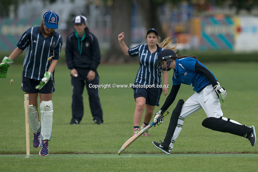 A Whangarei GHS player (R is run out during the St Hilda's Collegiate vs Whangarei GHS match in the NZCT College Girls Cup cricket tournament at Fitzherbert Park in Palmerston North on Thursday the 11th of December 2014. Photo by Marty Melville/www.Photosport.co.nz