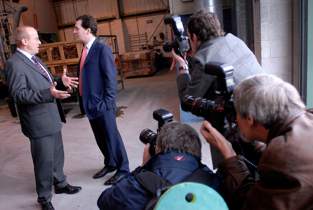 MP George Osborne, the Conservative Chancellor of The Exchequer during a visit to a rubber factory in Manchester.