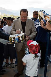 ARCADIA, CA - NOV 5: Legendary boxing promoter Bob Arum signs autographs during Mexican icon and three-division world champion Juan Manuel Marquez media workout at the Santa Anita Park  Breeders' Cup Classic Day. Presented by Santa Anita Park and Top Rank. MANDATORY CREDIT:  Photo © Eduardo E. Silva