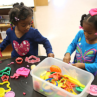 Lauren Wood | Buy at photos.djournal.com<br /> Peyton Jones, 3, left, and Carleigh Hardin, 4, play with play-doh Thursday morning at the NMMC Child Care Center.