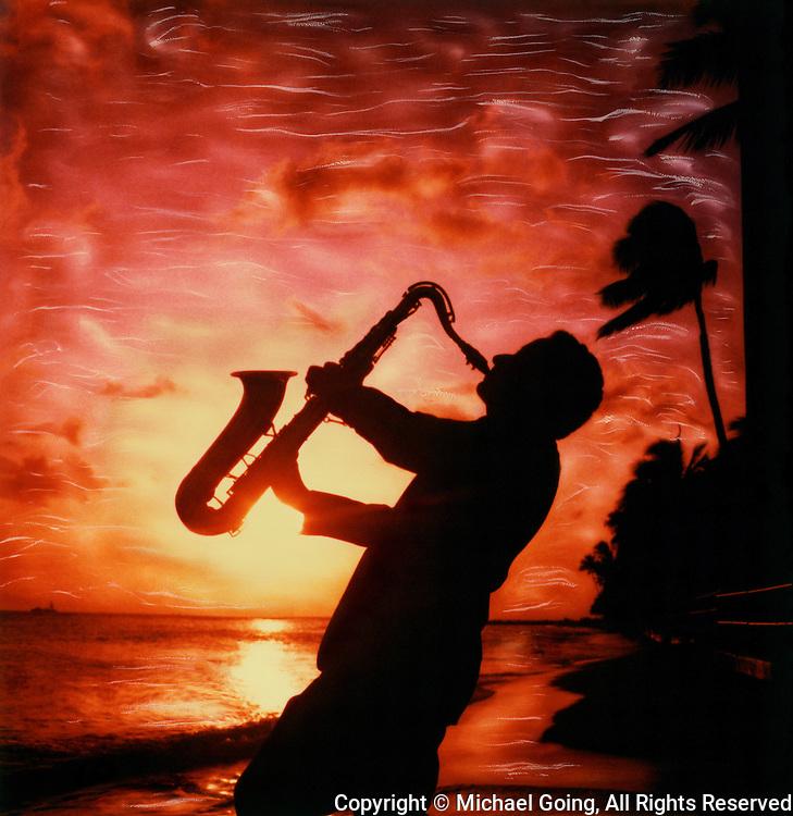Silhouette of Sax musician playing against intense red sunset Waikiki Beach, Hawaii