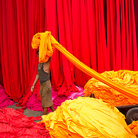 Worker at a dyed cloth factory in Rajasthan, India.