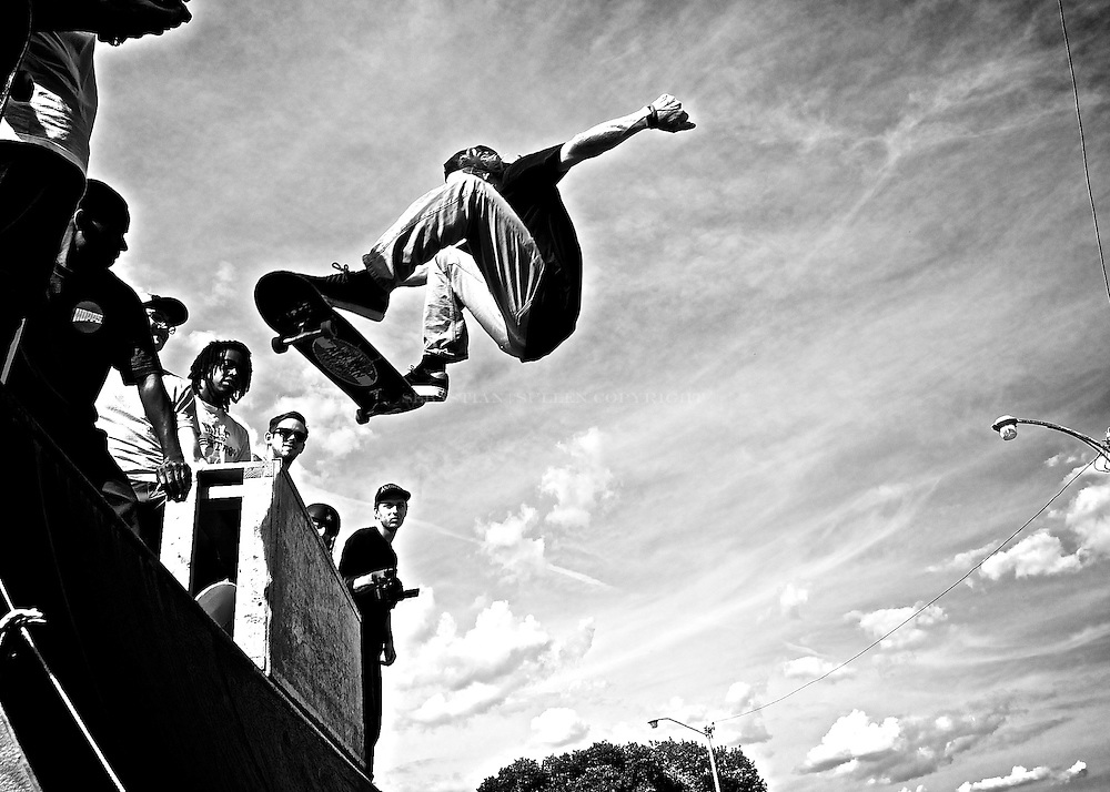 Skate boarders confidence flying through the air as onlookers gaze and wonder Corktown series