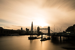 © Licensed to London News Pictures. 18/08/2017. LONDON, UK.  A subdued sunset behind Tower Bridge and the River Thames on London this evening following a day of snny weather and heavy rain showers in the capital today.  Photo credit: Vickie Flores/LNP