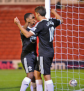 Picture by Richard Land/Focus Images Ltd +44 7713 507003<br /> 27/08/2013<br /> Gaston Ramirez (R) of Southampton celebrates making it 5-1 during the Capital One Cup match at Oakwell, Barnsley.