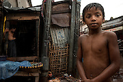 A boy is caught in a rainstorm along the Buriganga river.
