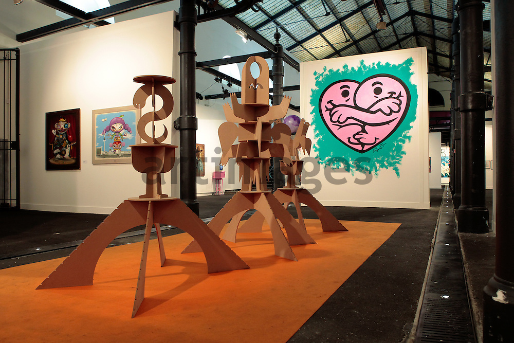 Tim Biskup , The Mystic Temple of Self Entitlement , 2009 ; behind painting by Ron English, behind left two paintings by Andreas Bartos