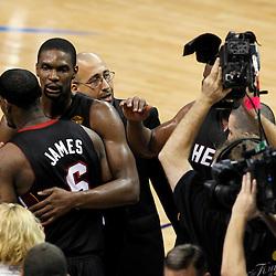 Jun 14, 2012; Oklahoma City, OK, USA;  Miami Heat small forward LeBron James (6) and Miami Heat power forward Chris Bosh (1) celebrate after defeating the Oklahoma City Thunder in game two in the 2012 NBA Finals at Chesapeake Energy Arena. Miami won 100-96. Mandatory Credit: Derick E. Hingle-US PRESSWIRE