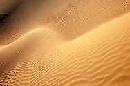 An image of diagonal desert sand pattern from the Sahara desert in Morocco.