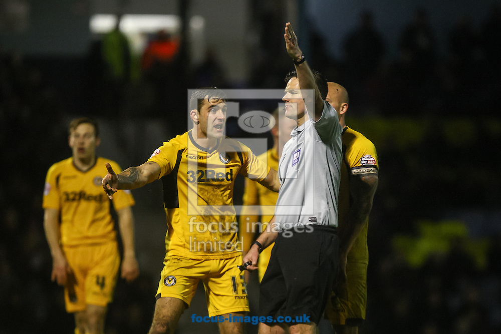 Picture by Daniel Chesterton/Focus Images Ltd +44 7966 018899<br /> 31/01/2014<br /> Andy Sandell of Newport County contests a decision by referee James Linington during the Sky Bet League 2 match at Roots Hall, Southend.