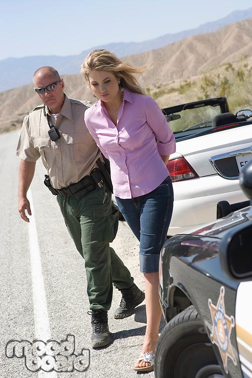 Police officer arresting female driver