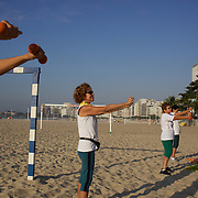 An early morning fitness class on Copacabana beach, Rio de Janeiro,  Brazil. 9th July 2010. Photo Tim Clayton..