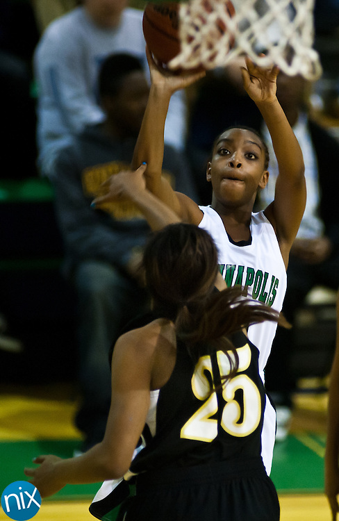 Kannapolis' Kalia Forrest shoots against Concord's Mariah Black Saturday night at A.L .Brown High School. Concord won the cross-town rivalry 60-46. (Photo by James Nix)