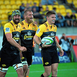 The Hurricanes celebrate Beauden Barrett's try during the Super Rugby match between the Hurricanes and Jaguares at Westpac Stadium, Wellington, New Zealand on Saturday, 9 April 2016. Photo: Dave Lintott / lintottphoto.co.nz