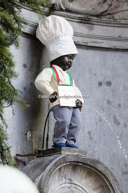 Brussels, Belgium, 2012 19 December. Belgian chocolate brand Leonidas starts celebrating its 100 years exitence in 2013. At the famous Belgian medieval statue Manneken Pis (peeing man) people gathered today.The statue dressed as a chocolatier