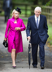 © London News Pictures. 14/09/2013.  Sir Charles Powell and Lady Carla Powell arriving for the wedding of Euan Blair, Son of former British Prime Minister Tony Blair,  to Suzanne Ashman at All Saints Parish Church in Wotton Underwood, Buckinghamshire. The wedding was attended by Former British Prime minister Tony Blair and his wife Cherie Blair. Photo credit: Ben Cawthra/LNP