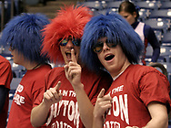 Tim Kollar (center) and Chris Ransdell (right) mug for the camera while Patrick Ransdell (left) looks for free stuff during a a time out in the UD Women's basketball game at the University of Dayton Arena, January 21, 2007.
