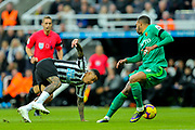 Kenedy (#15) of Newcastle United slips as he attempts to take on Etienne Capoue (#29) of Watford during the Premier League match between Newcastle United and Watford at St. James's Park, Newcastle, England on 3 November 2018.