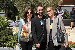 Left to right, OLIVIA HARRISON, RINGO STARR and BARBARA BACH at the 2011 RHS Chelsea Flower Show VIP & Press Day at the Royal Hospital Chelsea, London, on 23rd May 2011.