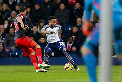 Stephane Sessegnon of West Brom is challenged by Kyle Naughton of Swansea City - Photo mandatory by-line: Rogan Thomson/JMP - 07966 386802 - 11/02/2015 - SPORT - FOOTBALL - West Bromwich, England - The Hawthorns - West Bromwich Albion v Swansea City - Barclays Premier League.