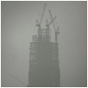 "A high-rise building under construction is seen through the smog in Beijing.<br /> For years, China has resisted any outside pressure to curb their greenhouse gas emissions, citing their need and right to develop their economy. USA and China are the biggest carbon polluters in the world, and with both nations absent from international climate agreements, earlier climate negotiations have ended in toothless compromises.<br /> That could change with the COP21 Climate Conference in Paris. Already in December last year, both China and USA announced joint commitment to reduce emissions and increase renewable energy to 20 percent by 2030. China already has a substantial carbon trading system in place, second only to EU, and today (Sep 25th 2015) President Xi Jinping of China will announce how their cap-and-trade system can help to halt their growth of emissions by 2030. <br /> Speaking to Rolling Stone Magazine one year ago, Dan Dudeck (VP of the Environmental Defense  Fund) said ""If China is successful in using market forces to cap carbon and transform its economy, that may be the best shot we have to limit climate change."""
