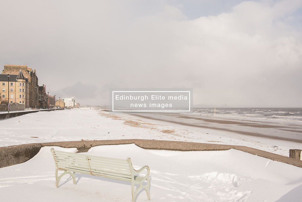 It doesn't happen very often but this morning there was a thick blanket of snow on Portobello beach. Beach volleyball pair Mel Coutts and Lynne Beattie must be delighted to be in Fort Lauderdale for their Commonwealth Games preparation and not training on their usual court!<br /> <br /> <br /> © Jon Davey/ EEm