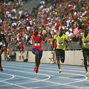 GAY - 13USA, Des Moines, Ia. - Tyson Gay won the 100 with Justin Gatlin, left, second.  Photo by David Peterson