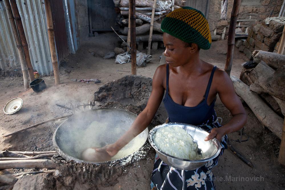 8 April 2010, Ugbekuma, Cross River, Nigeria..Frying grated cassava called garri in Nigeria. Garri is a staple meal in southern Nigeria.