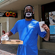 A private worker wears a facemark as he grabs his lunch on Monday, March 30, 2020 in Orlando, Florida. (Alex Menendez via AP)