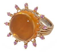 sunburst ring with orange and purple gems