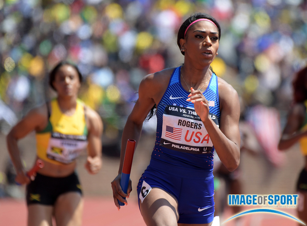 Apr 28, 2018; Philadelphia, PA, USA; Raeven Rogers runs the 400m anchor leg on the USA Red women's sprint medley relay that won in a world-record 1:35.20 during the 124th Penn Relays at Franklin Field.