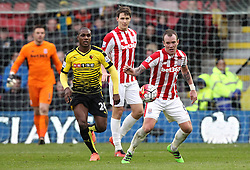 Glenn Whelan of Stoke City controls the ball as Odion Ighalo of Watford closes down - Mandatory byline: Robbie Stephenson/JMP - 19/03/2016 - FOOTBALL - Vicarage Road - Watford, England - Crystal Palace v Leicester City - Barclays Premier League