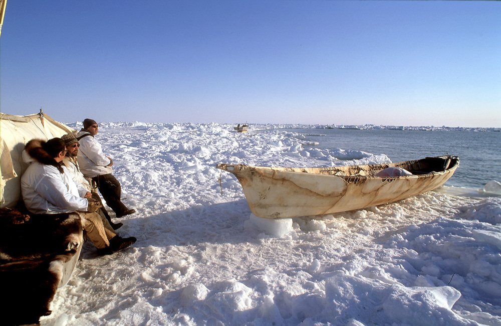 Whaling crew waiting at their camp on the edge of the sea ice on the Chukchi Sea and scanning the water for sightings of a bowhead whale