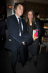 BRYAN FERRY and SABRINA GUINNESS at the launch of Nicky Haslam's autobiography Redeeming Features held at Aqua Nueva, 240 regent Street, London on 5th November 2009.