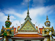 "11 SEPTEMBER 2017 - BANGKOK, THAILAND: Hanuman, the Monkey God, guards the main entrance to Wat Arun. Renovations are nearly finished at Wat Arun on the Thonburi side of the Chao Phraya River in Bangkok. Wat Arun is famous for its Khmer style main ""prang"" (chedi). It was originally built in the Ayutthaya Period and rebuilt to its current form in the time of Rama II.       PHOTO BY JACK KURTZ"