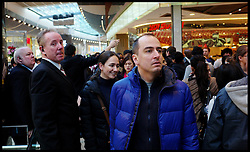 Security Staff guide Shoppers at the Westfield Shopping Centre in Stratford, East London looking for bargains in the Boxing Day Sales, Monday December 26, 2011. Photo By Andrew Parsons/i-Images