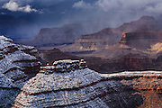 Snow falling into the Grand Canyon.