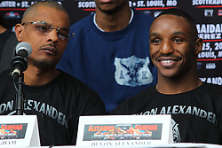 """Feb 23; St. Louis, MO, USA; Devon Alexander (right) and trainer Kevin Cunningham (left during the final press conference for the February 25, 2012 fight card """"Arch Enemies"""".  Mandatory Credit: Ed Mulholland"""