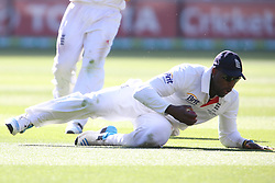 © Licensed to London News Pictures. 27/12/2013. Michael Carberry slides to stop the ball during Day 2 of the Ashes Boxing Day Test Match between Australia Vs England at the MCG on 27 December, 2013 in Melbourne, Australia. Photo credit : Asanka Brendon Ratnayake/LNP