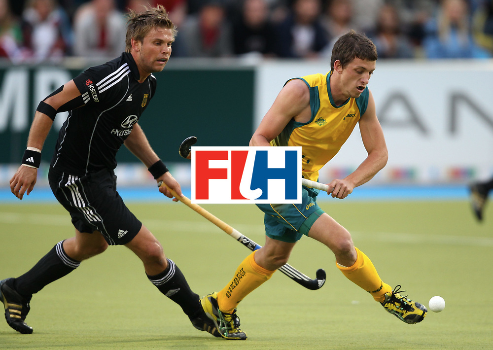 Mens Champions Trophy, Monchengladbach 2010<br /> Day 4, Australia v Germany 5/8/10<br /> Moritz Fuerste and Simon Orchard.<br /> Credit: Grant Treeby.<br /> Editorial use only(No Archiving)