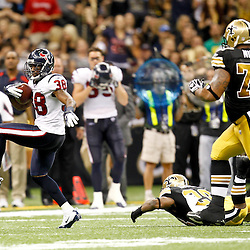 September 25, 2011; New Orleans, LA, USA; Houston Texans safety Danieal Manning (38) returns an interception during the third quarter against the New Orleans Saints at the Louisiana Superdome. The Saints defeated the Texans 40-33. Mandatory Credit: Derick E. Hingle